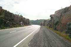 Trans-Canada Highway through a deep rock cut, east of THunder Bay